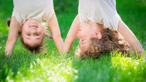 Happy children standing upside down