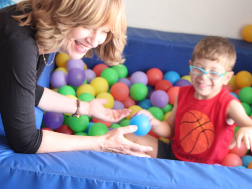 Ruth Perednik playing with a boy